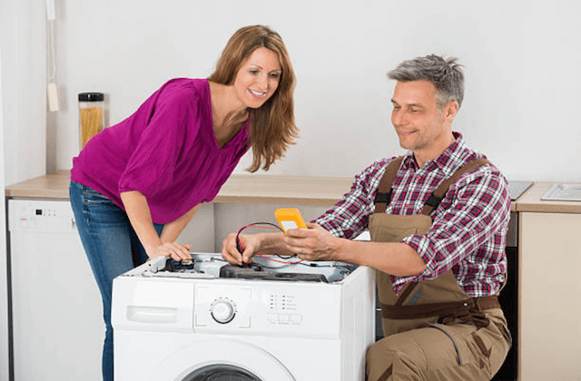 appliance repairman with customer